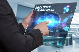 Business, Technology, Internet and network concept. Business man working on the tablet of the future, select on the virtual display: SECURITY AWARENESS